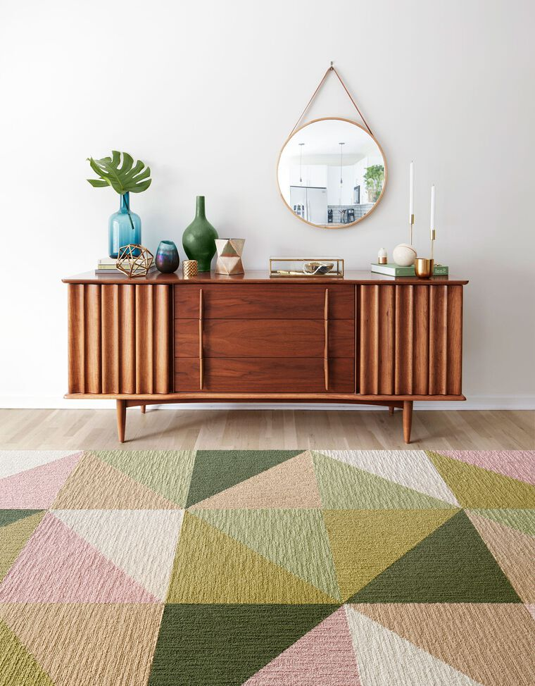 Lifestyle Image of Mid-Century Modern credenza with green, teal, and gold accents showing the New Signature Rug Garden Variety